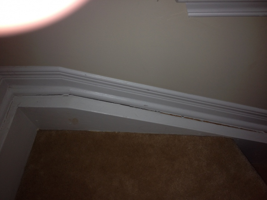 Baseboards separating from wall in stairs-024.jpg