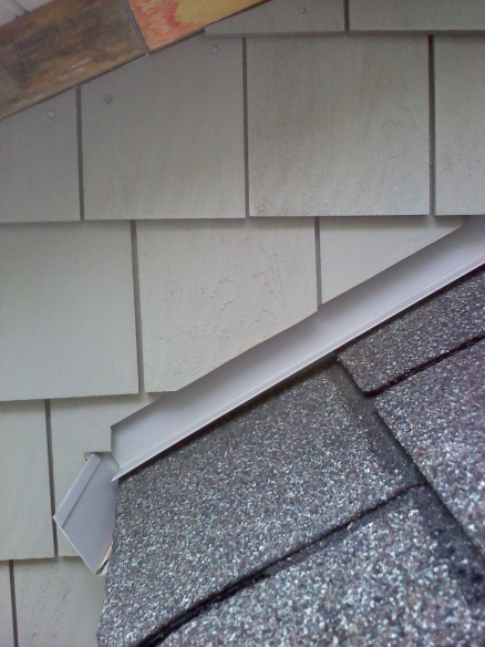 How can I fix the rotten T-111 above shingles and under gutter?-0514111802.jpg
