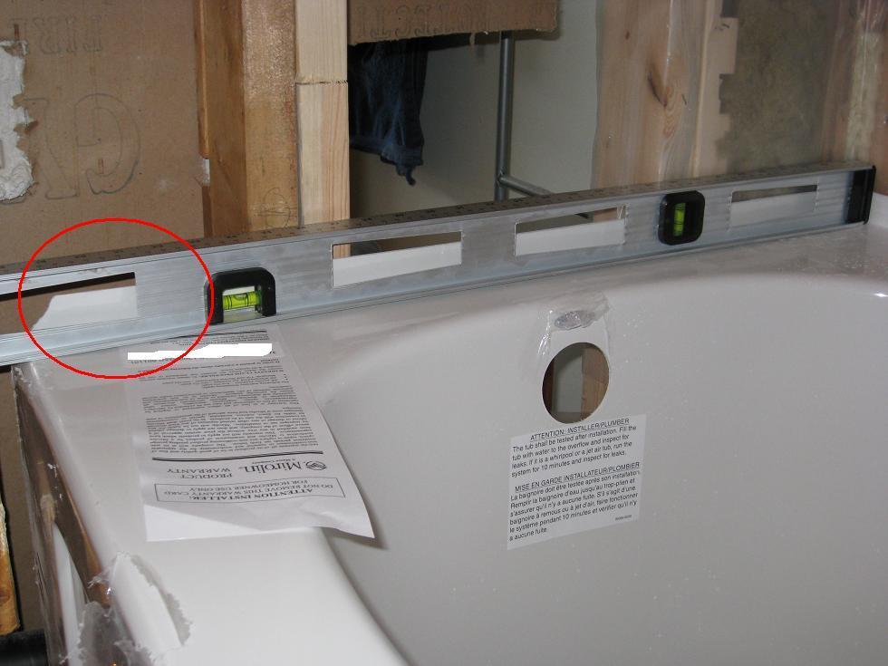 Stuck on Bathtub Installation-06-skirt-side-requires-0.5-inch-raise.jpg