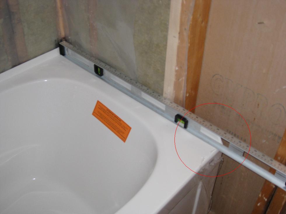 Stuck on Bathtub Installation-07-rear-end-requires-0.125-0.25-raise.jpg