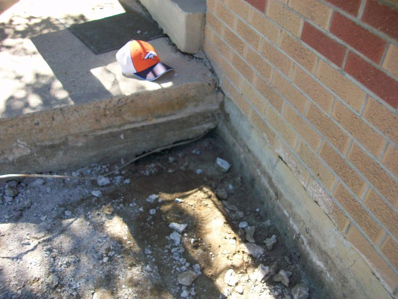 cracked driveway + leaning retaining wall = now what?-100_1084b.jpg