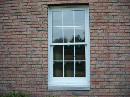 Window caulking gather your materials a putty knife or for Cheap vinyl windows