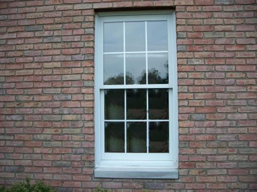 Caulking Vinyl Windows in brick-100_6654.jpg
