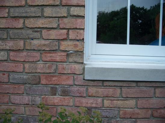 Caulking Vinyl Windows in brick-100_6660.jpg