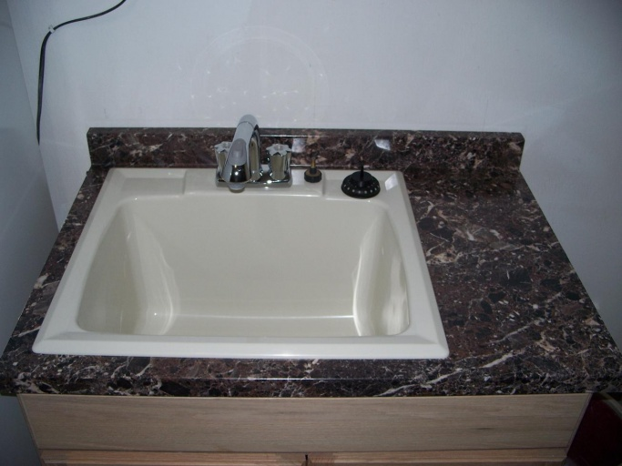 "Can bath sink and service sink drain into 1.5"" branch drain-100_9587.jpg"