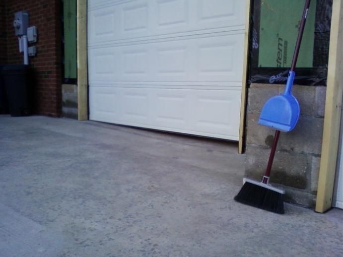 ... Garage DOOR WAY OFF DUE TO Uneven Slope!