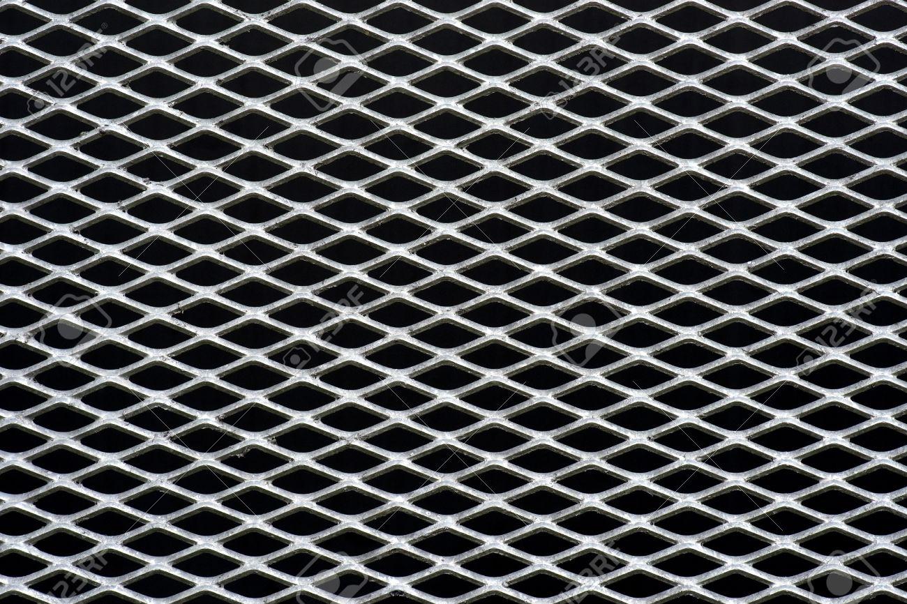 Removing mortar-14127712-metal-grid-regular-pattern-black-background.jpg