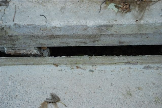 Proper methods to fill concrete gaps, holes, cracks and resurface concrete-1and-half-inch-horizontal-gap.jpg