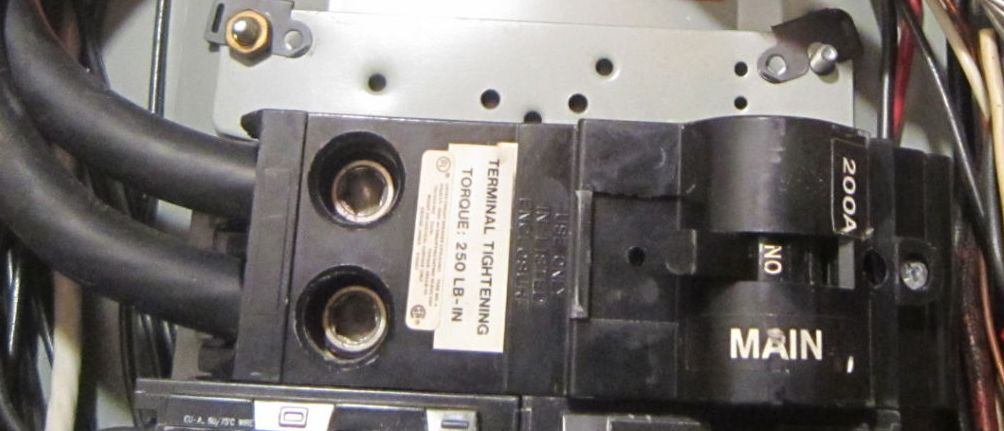 Help trying to identify Main Panel circuit breaker Interlock solution-200a_hump_breaker.jpg