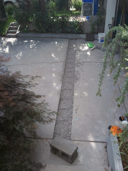Driveway sloped toward garage, floods garage in heavy rain.-2011-07-30_17.45.50.jpg