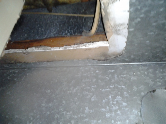 Open studs and insulation in duct behind honeywell humidfier filter-2011-10-04-20.09.05.jpg