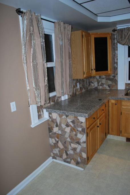 leaning heavily towards tiling couter tops, need advice-2011-11-16-drumheller-01-house-102-inspection-day-05.jpg