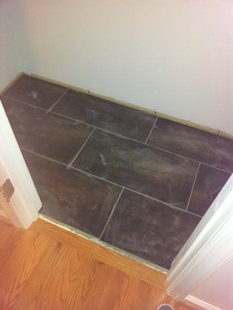 How would you do the transition for this bathroom?-20111216_163357.jpg