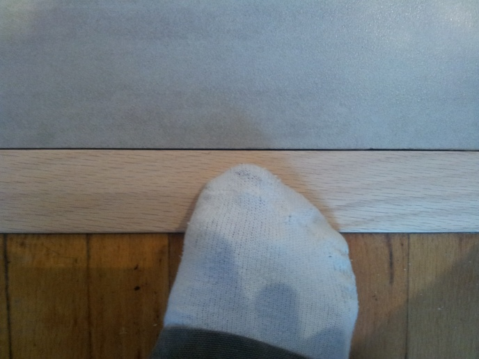 What to put between the wood and tile?-20130128_144530.jpg