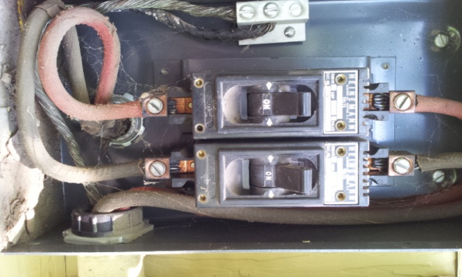 Add 14-50 240v 50amp plug in garage or Add entire panel and 240v plug on Old House.-20130605_154053.jpg