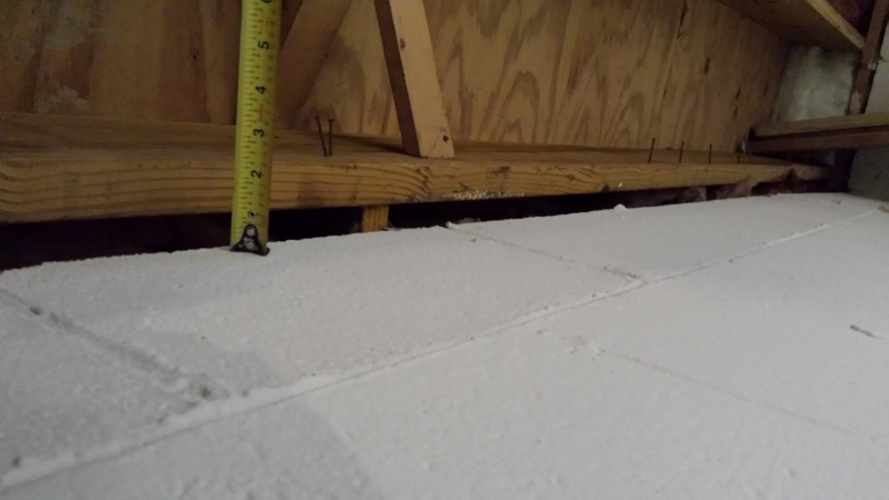 Installing supporting beams on basement wall-20140226_173243.jpg