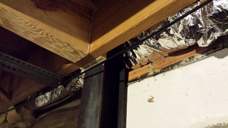 Installing supporting beams on basement wall-20140226_173330.jpg
