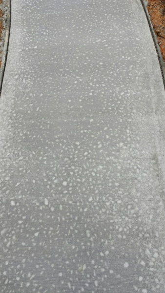White Spots On Newly Poured Driveway Concrete Stone
