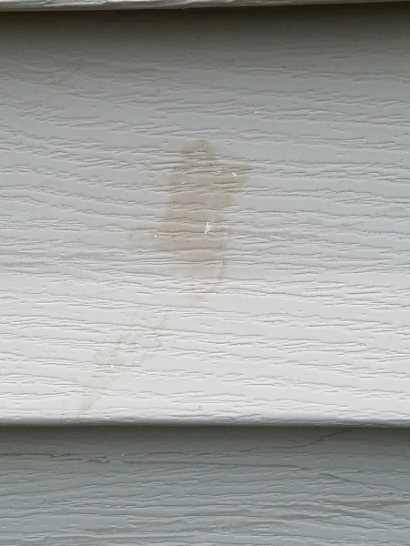 Blotchy Stains Vinyl Siding After Power Washing Deck