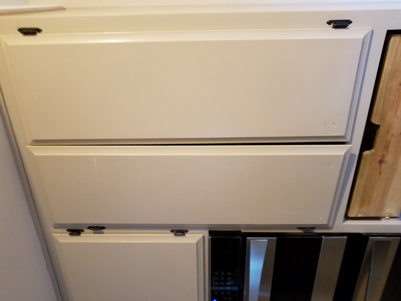 rehanging kitchen cabinets-20170714_194550.jpg