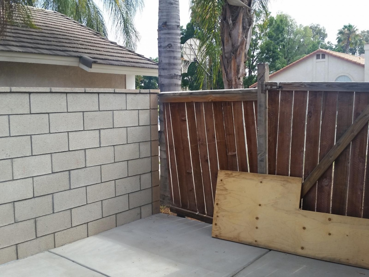 can i hang a gate off of a 6ft cinder block wall