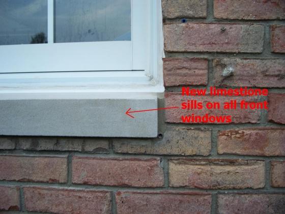 Caulking Vinyl Windows in brick-2222.jpg