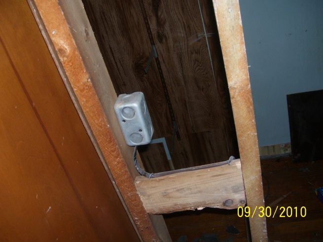 My house's previous owner - DIY horror stories-2f-bedroom2-closet-outlet-wired-lamp-cord.jpg