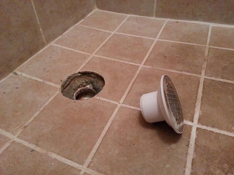 how to repair tiled shower drain leak