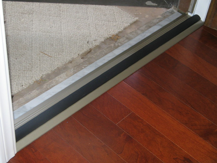 Adhesive for Marble Threshold-4-rubber-weather-strip-installed.jpg
