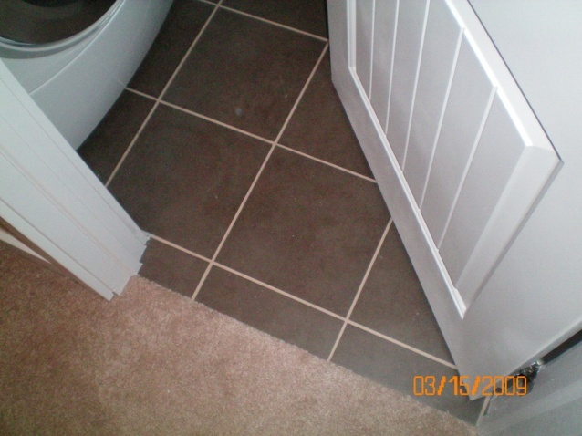Tile transition(s). Are these correct? Please respond. Thanks.-48a-laundry-room-transition-open.jpg