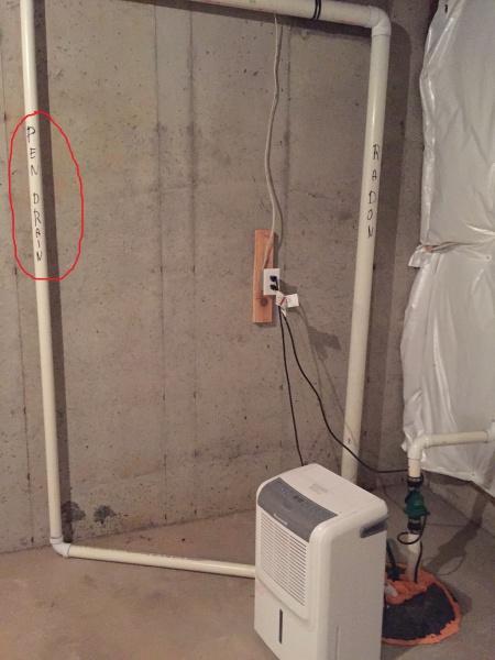 Pen drain pipe in basement-871.jpg
