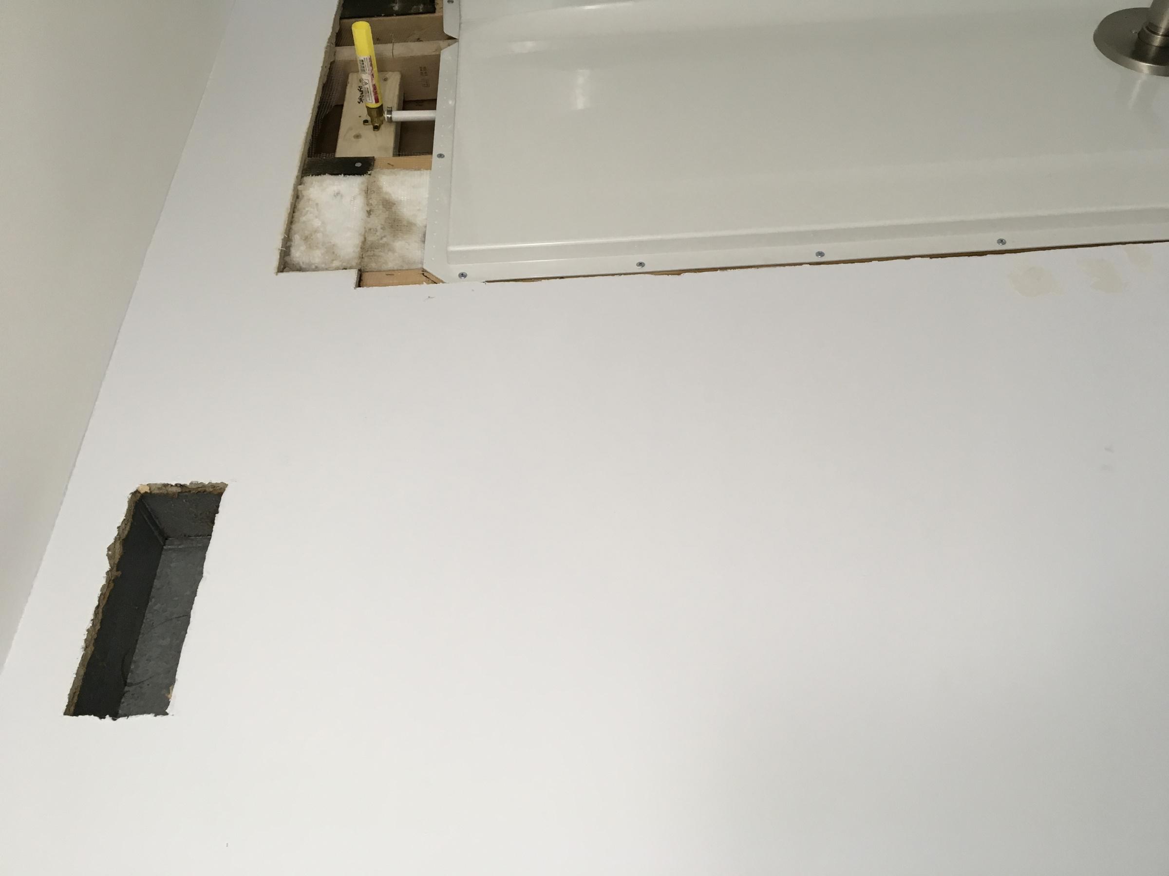 Impossible drywall around tub surround-89fed25b-5c43-4c8c-a373-767530e5fdf8.jpg