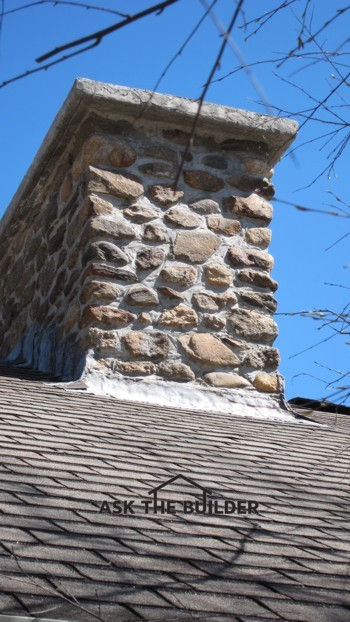 Copper Flashing On Irregular Rock Chimney Roofing Siding