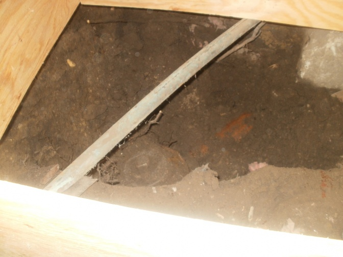 Digging footing pads, abandon sewer pipes and moldy dirt-abandoned-sewer-pipe.jpg