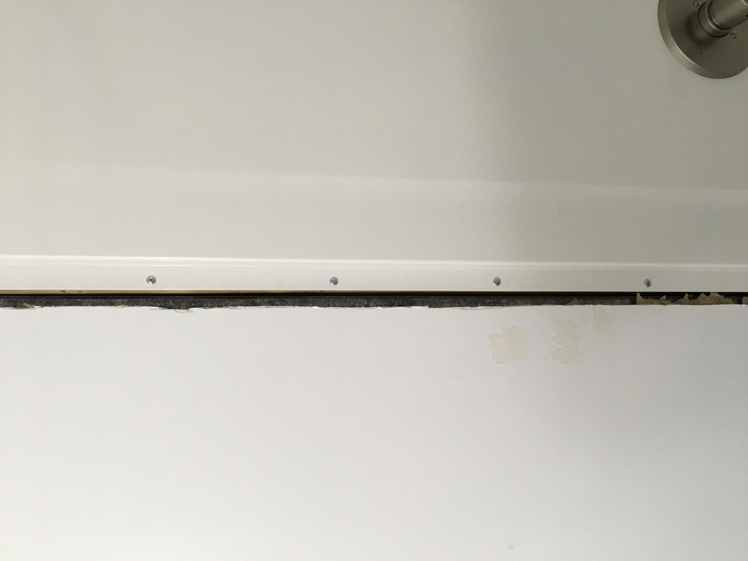 Impossible drywall around tub surround-b74f9d24-ca45-46e1-a387-7c1846db5725.jpg