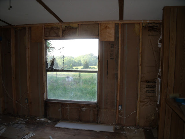 Complete Mobile Home Remodel-back-wall-bare.jpg