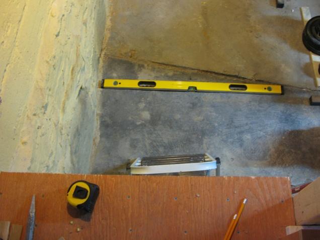 options for building stairs on lumpy basement floor-basement_floor.jpg