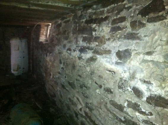 Sister Wall Against Old Stone, How To Fix A Stone Basement Wall