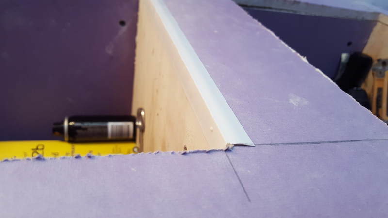 Need help making seamless smooth transition where drywall meets plywood bthroom shelf-bath2.jpg
