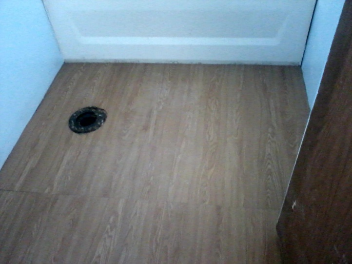 Why does my newly installed toilet rock back and forth?-bathroom-floor-2.jpg