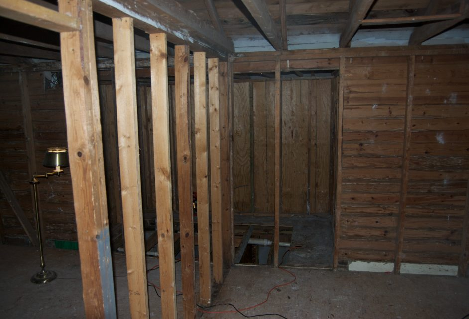 Bubba's been here. Repairing sagging rim/floor joists.-bathroom-wall.jpg