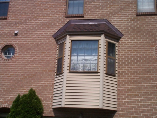 Aluminum flashing showing through shingles on new bay window roof-bay3.jpg
