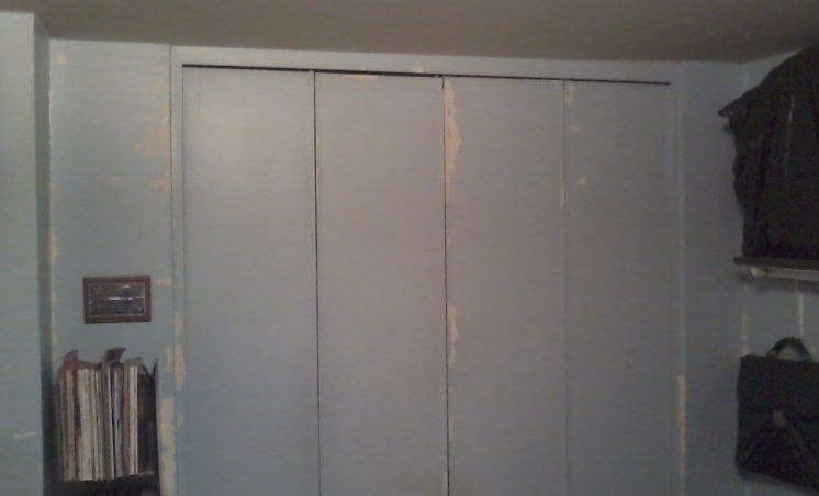 updating 1970's plain closet bi-fold doors-bedroom-closet.jpg