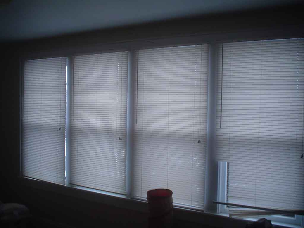 Why are my windows leaking?!-bedroom_windows_inside.jpg