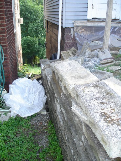 Rebuilding a Retaining Wall-before-more-less.jpg