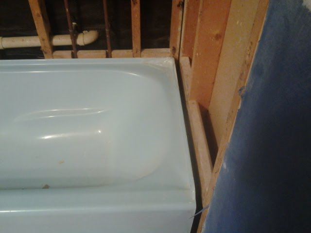 Installing a tub, need advice on 1in gap between end of the tub and studs.-br3.jpg