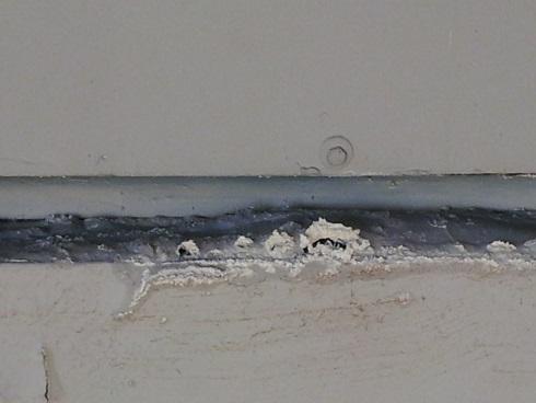 Crumbling plaster: water damage?-building2.jpg