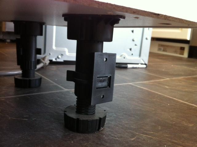 Caulking where toe kick meets floor in kitchen-cabinet-foot.jpg
