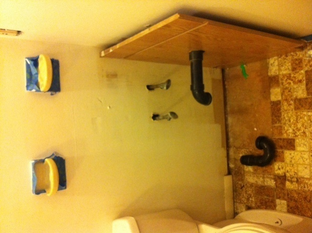 Bathroom sink drain pipe on the side of the wall-cabinet-space.jpg