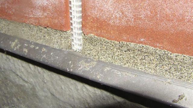 Stone veneer meets siding...flashing?-cap.jpg